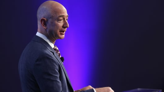 Amazon founder and Washington Post owner Jeff Bezos speaks during the opening ceremony of the media company's new location.
