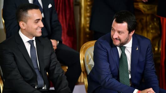 Italys Labor and Industry Minister and deputy PM Luigi Di Maio (L) and Italys Interior Minister and deputy PM Matteo Salvini smile before the swearing in ceremony of the new government at Quirinale Palace in Rome on June 1, 2018.