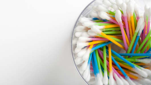 Colorful cotton swabs arranged in a cup