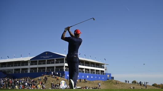 Tiger Woods plays a tee shot during his singles match with Europe's Spanish golfer Jon Rahm on the third day of the 42nd Ryder Cup at Le Golf National Course at Saint-Quentin-en-Yvelines, south-west of Paris, on September 30, 2018.