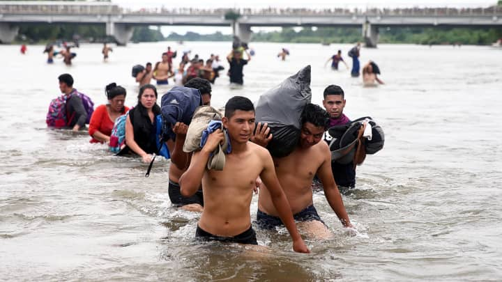 Central American migrants, part of a caravan trying to reach the U.S., cross the Suchiate River to avoid the border checkpoint in Ciudad Hidalgo, Mexico, October 20, 2018.