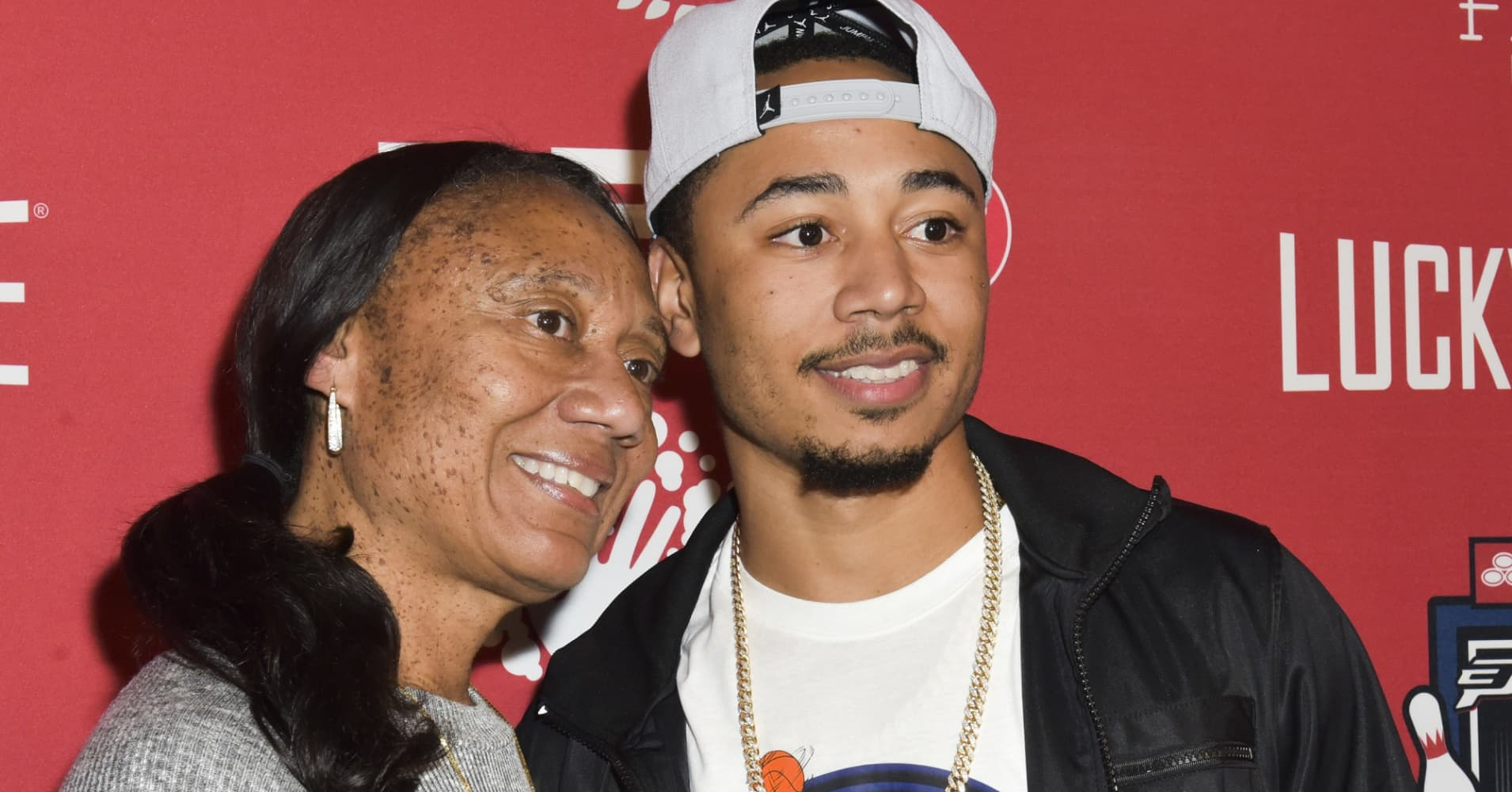 Mookie Betts (R) with his mother, Diana Collins (L).