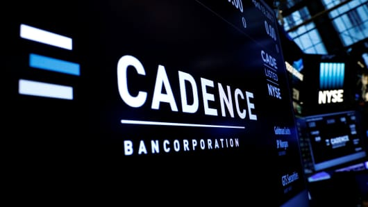A logo and ticker info for Cadence Bancorp, LLC is displayed on a screen during the company's IPO, on the floor of the New York Stock Exchange (NYSE) in New York, U.S., April 13, 2017.
