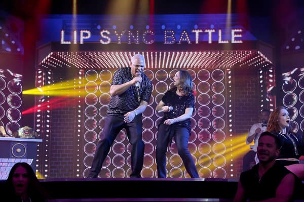 Carnival Cruise Line CEO Arnold Donald and Carnival President Christine Duffy perform in a Lip Sync Battle as part of the naming celebration for the Carnival cruise ship Horizin on May 23, 2018 in New York City.