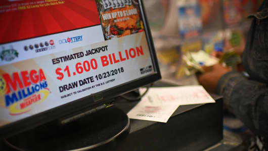 A woman buys Mega Millions tickets hours before the draw of the $1.6 billion jackpot, at a liquor store in Downtown Washington DC, on October 23, 2018.