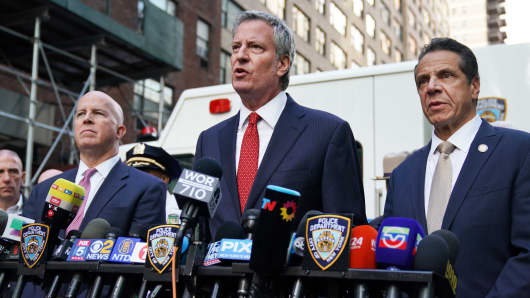 New York City Police Commissioner James ONeil,  New York City Mayor Bill de Blasio and New York Governor Andrew Cuomo attend a news conference outside the Time Warner Building on October 24, 2018, after an explosive device was delivered to CNN's New York bureau.