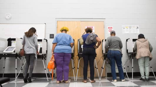 Voters cast ballots during the early voting period at C.T. Martin Natatorium and Recreation Center on October 18, 2018 in Atlanta, Georgia.