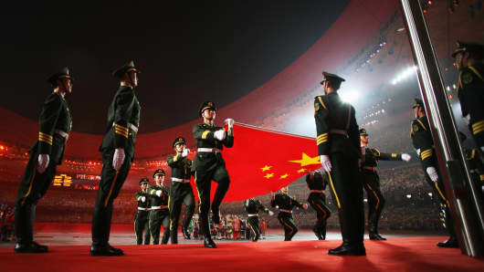 The Chinese flag is carried by the military during the Opening Ceremony for the 2008 Beijing Summer Olympics at the National Stadium on August 8, 2008 in Beijing, China.