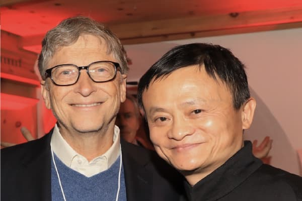 Alibaba Group's executive chairman Jack Ma and Microsoft founder Bill Gates at Alibaba's Chinese culture feast on the first day of the World Economic Forum 2018 Annual Meeting on January 23, 2018 in Davos, Switzerland.
