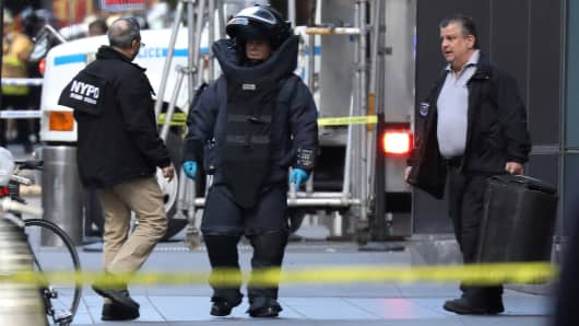 A member of the New York Police Department bomb squad is pictured outside the Time Warner Center in the Manhattan borough of New York City after a suspicious package was found inside the CNN Headquarters in New York, U.S., October 24, 2018.