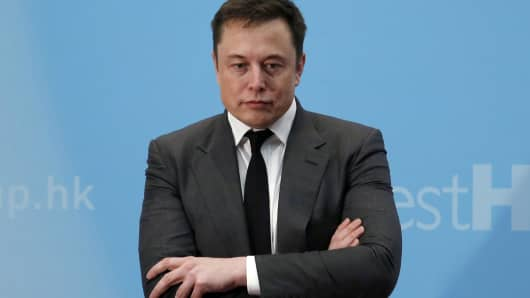 Tesla Chief Executive Elon Musk stands on the podium as he attends a forum on startups in Hong Kong, China.