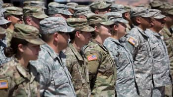 Members of the Arizona National Guard listen to instructions on April 9, 2018, at the Papago Park Military Reservation in Phoenix. - Arizona deployed its first 225 National Guard members to the Mexican border on Monday after President Donald Trump ordered thousands of troops to the frontier region to combat drug trafficking and illegal immigration.