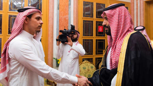 Saudi Crown Prince Mohammed bin Salman, right, shakes hands with Salah Khashoggi, a son, of Jamal Khashoggi, in Riyadh, Saudi Arabia, on Tuesday, Oct. 23.
