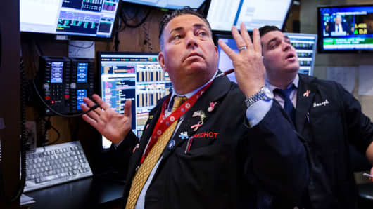 Traders work on the floor of the New York Stock Exchange (NYSE) in New York, on Friday, Oct. 12, 2018.