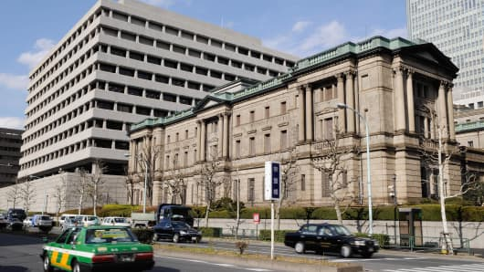 Cars go past the headquarters of the Bank of Japan in Tokyo on March 6, 2008.