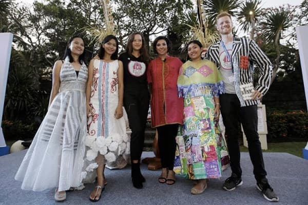 Melati Wijsen and friends modelling plastic-free fashion at the International Monetary Fund-World Bank meetings in Bali