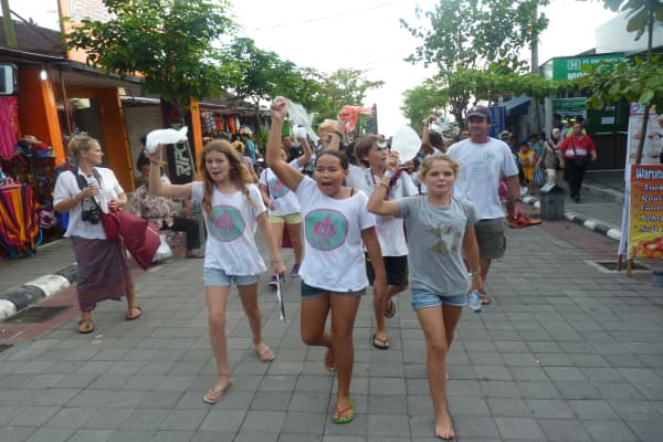 Isabel Wijsen (middle), co-founder of Bye Bye Plastic Bags, goes on the streets of Bali to raise awareness on plastic pollution.