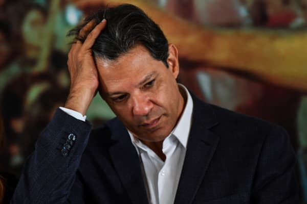 Brazil's presidential candidate for the Workers' Party (PT), Fernando Haddad gestures during a meeting with a group of evangelical pastors, in Sao Paulo, Brazil, on October 17, 2018.
