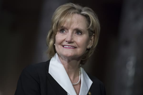 Sen. Cindy Hyde-Smith, R-Miss., attends her swearing-in ceremony in the Capitol's Old Senate Chamber after being sworn in on the Senate floor on April 9, 2018.