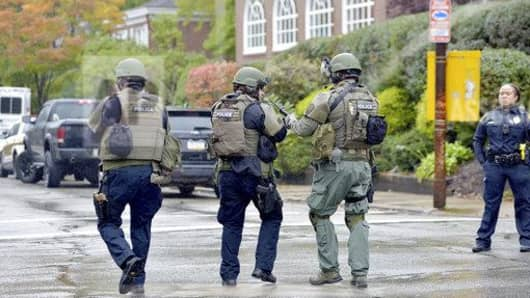 Police respond to an active shooter situation at the Tree of Life synagogue on Wilkins Avenue in the Squirrel Hill neighborhood of Pittsburgh, Pa., on Saturday, October 27, 2018.