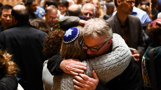People hug after a vigil, to remember the victims of the shooting at the Tree of Life synagogue the day before, at the Allegheny County Soldiers Memorial on October 28, 2018, in Pittsburgh, Pennsylvania.