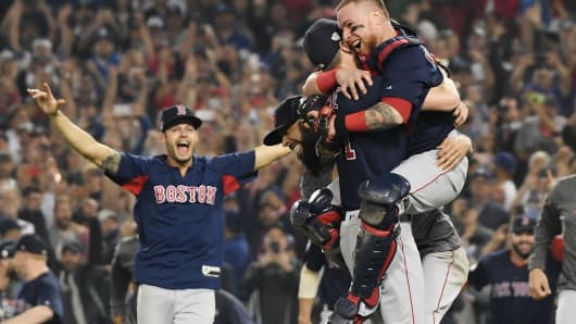 Christian Vazquez  jumps into the arms of Chris Sale of the Boston Red Sox to celebrate their 5-1 win over the Los Angeles Dodgers in Game Five to win the 2018 World Series at Dodger Stadium on October 28, 2018 in Los Angeles, California.