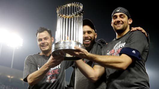 Joe Kelly #56, David Price #24 and Nathan Eovaldi #17 of the Boston Red Sox pose for a photo with the Commissioner's Trophy after the Red Sox defeated the Los Angeles Dodgers in Game 5 of the 2018 World Series at Dodger Stadium on Sunday, October 28, 2018 in Los Angeles, California.