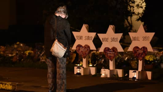 A woman bows her head in front of a memorial on October 28, 2018, at the Tree of Life synagogue after a shooting there left 11 people dead in the Squirrel Hill neighborhood of Pittsburgh on October 27.