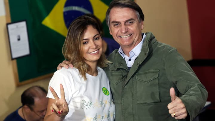 Jair Bolsonaro, far-right lawmaker and presidential candidate of the Social Liberal Party (PSL), and his wife Michelle pose as they arrive to cast their votes, in Rio de Janeiro, Brazil October 28, 2018.