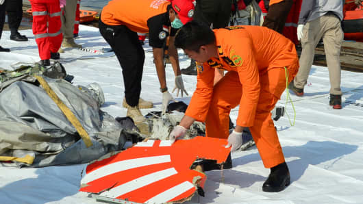 Rescue team members arrange the wreckage, showing part of the logo of Lion Air flight JT610, that crashed into the sea, at Tanjung Priok port in Jakarta, Indonesia, October 29, 2018.