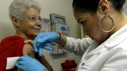 A patient from New York is given a flu shot by a Medical Assistant in New York.