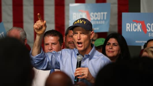 Florida Governor Rick Scott addresses supporters as he holds a Senate campaign rally at the Interstate Beverage Corp. on April 10, 2018 in Hialeah, Florida.