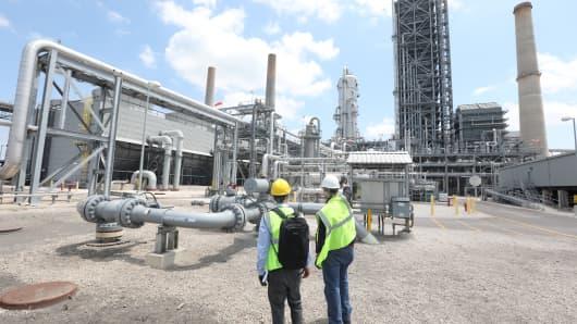 Timothy Gardner and David Knox are seen next to a Petra Nova CCS Facility at NRG Power Plant in Richmond, Texas, U.S., May 18, 2018.
