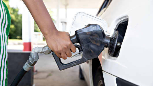 A customer fuels a vehicle at a ConocoPhillips gas station in Peoria, Illinois, U.S., on Tuesday, July 24, 2018.