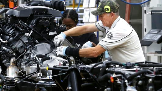 Fiat Chrysler Automobiles assembly workers build 2019 Ram pickup trucks at the FCA Sterling Heights Assembly Plant in Sterling Heights, Michigan, October 22, 2018.