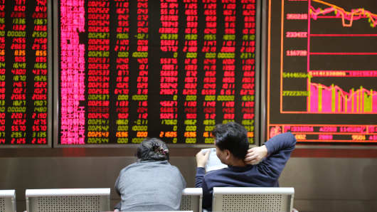 Investors observe stock market at an exchange hall on January 6, 2016 in Beijing, China.
