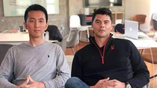 Ethos co-founders Lingke Wang, left, and Peter Colis, right.