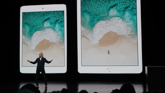 Apple CEO Tim Cook shows existing iPads in New York on Oct. 30, 2018.