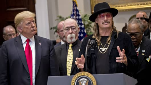 Musician Kid Rock, right, speaks as U.S. President Donald Trump, left, listens during a signing ceremony for H.R. 1551, the Hatch-Goodlatte Music Modernization Act, in the Roosevelt Room of the White House in Washington, D.C., U.S., on Thursday, Oct. 11, 2018.
