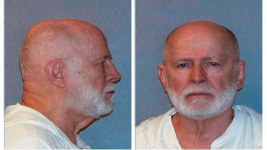 "Former mob boss and fugitive James ""Whitey"" Bulger is seen in a combination of booking mug photos released to Reuters on August 1, 2011."