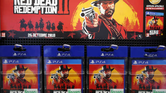 "Copies of ""Red Dead Redemption 2"" for Sony PlayStation 4 are displayed inside a shop in Paris."