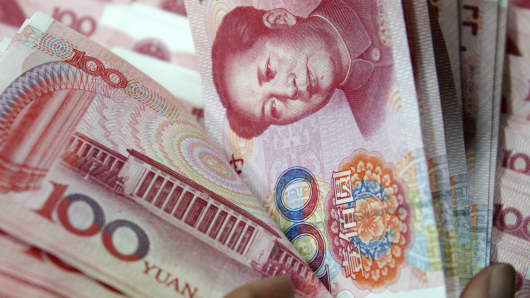 Chinese yuan notes at a branch of Industrial and Commercial Bank of China.