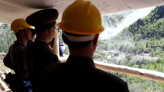 In this handout image provided by the News1-Dong-A Ilbo, North Korean officials watch the demolition of the Punggye-ri nuclear test site on May 24, 2018 in Punggye-ri, North Korea.