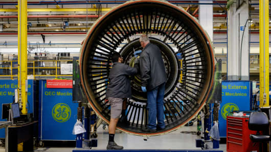 Men work with a jet engine at General Electric (GE) Celma, GE's aviation engine overhaul facility in Petropolis, Rio de Janeiro, Brazil.