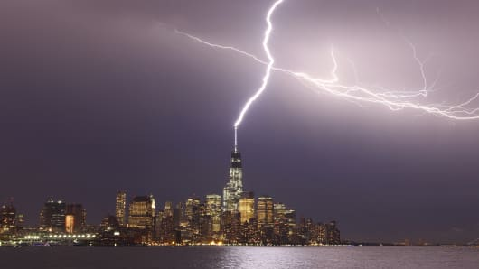 Lightning hits One World Trade Center in Lower Manhattan during an early evening storm in New York.
