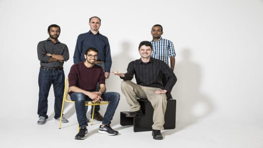 The University of Washington engineers behind RoboFly. Back row (left to right): Yogesh Chukewad, Sawyer Fuller, Shyam Gollakota. Front row: Vikram Iyer, Johannes James.