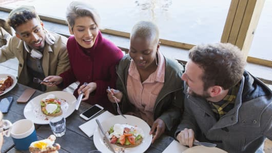 Friends eating breakfast at restaurant
