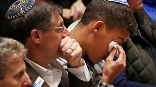 Mourners react during a memorial service at the Sailors and Soldiers Memorial Hall of the University of Pittsburgh, a day after 11 worshippers were shot dead at a Jewish synagogue in Pittsburgh, Pennsylvania, October 28, 2018