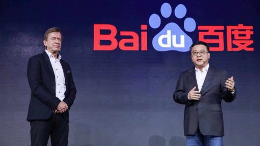 Hakan Samuelsson, president and chief executive of Volvo Cars, left, on stage at Baidu World 2018, alongside Ya-Qin Zhang, president of Baidu.