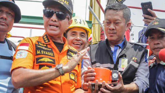 Chief of National Search and Rescue Agency Muhammad Syaugi (L) shows part of the black box of Lion Air's flight JT610 airplane, on Baruna Jaya ship, in the north sea of Karawang, Indonesia, November 1, 2018.